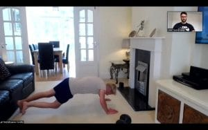 Client performing press up at home in West Cross during 1-2-1 session A personal trainer Swansea