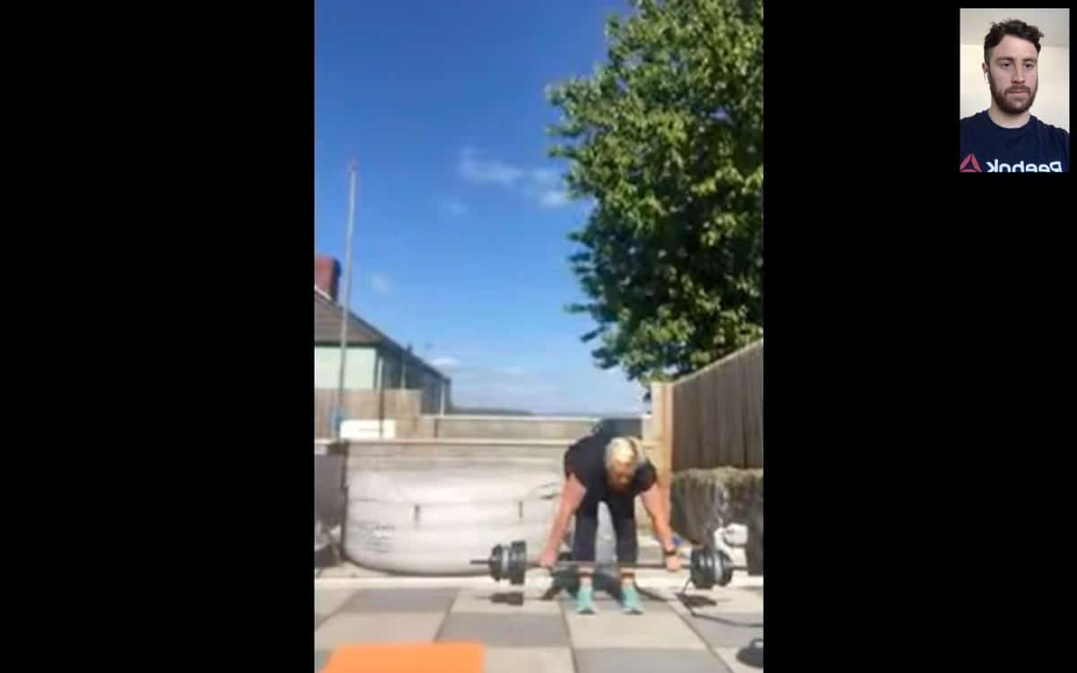 Lady in Manselton doing Bent over rows with Personal trainer in Swansea